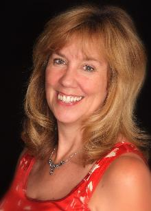 Carol McLellan - orange top